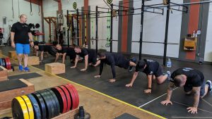 Hofman performing first responder training in firehouse weight room